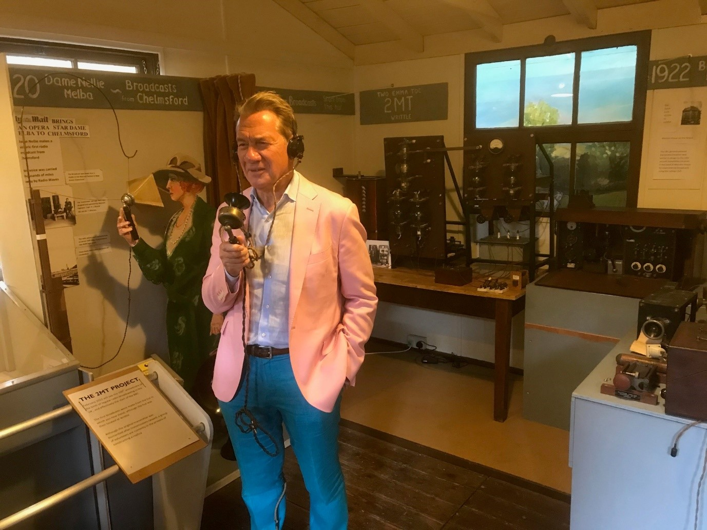 Great British Railway Journeys presenter Michael Portillo trying out an original microphone in the Writtle Hut.